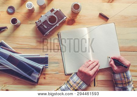 Photographer Planning A Photo Shooting, Writing Notes And To Do List In Note Book, Top View