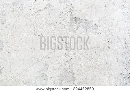 Patchy Texture Of Rough Concrete Wall Or Abstract Stucco Pattern. Light Gray Background. Modern Inte
