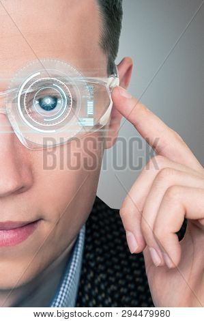 A Man In Augmented Reality Glasses With A Head Up Display.