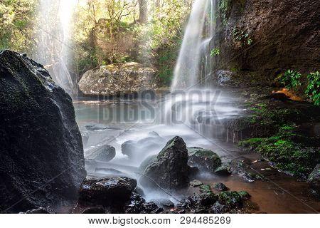 Waterfall Cascades Over Rock Ledges As It Meanders Through Beautiful Australian Bushland