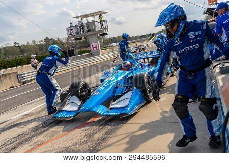 April 07, 2019 - Birmingham, Alabama, USA: FELIX ROSENQVIST (R) (10) of Sweden brings his car in for service during the Honda Indy Grand Prix of Alabama at Barber Motorsports Park