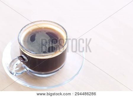 Closeup Glass Of Hot Americano Coffee On Wood Table, Selective Focus, Vintage Tone