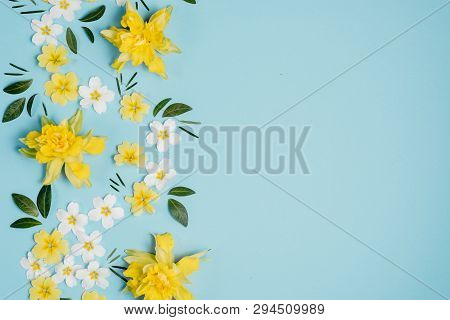 Creative Background Made Of White And Yellow Flowers On Pastel Blue Wall. Spring, Summer Concept. Fl