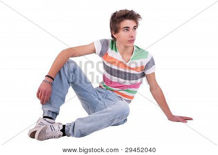Young Man Sitting, Isolated On White, Studio Shot