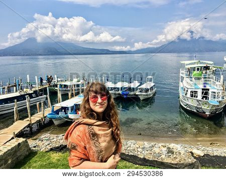 Lake Atitlan, Guatemala - May 20th, 2018: A Young Beautiful Tourist Standing At The Shores Of Lake A