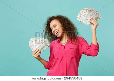 Happy African Girl In Casual Clothes Holding Fan Of Money In Dollar Banknotes, Cash Money Isolated O