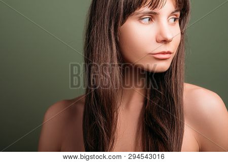 Watchful Beautiful Girl. Curious Facial Expression. Closeup Portrait Of Emotional Brunette Lady With