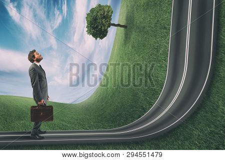 Businessman Observes The Road Uphill In Front Of Him. Achievement Business Goal And Difficult Career