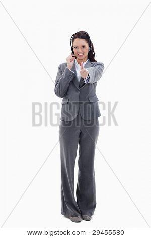 geschäftsfrau Genehmigung mit einem Headset against white background
