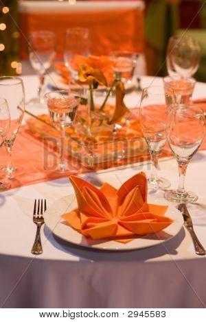 Orange Table Set For A Wedding Dinner