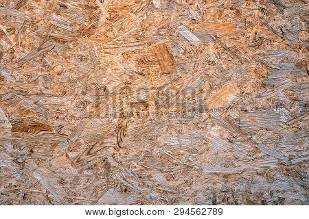 OSB boards compressed sawdust or chipboard. Abstract texture background compressed sawdust or pressed wooden panel. Close-up. poster
