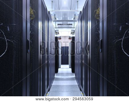 Server Room Data Center Network For Virtual Hosting Services. Corridor Inside With Racks Of Supercom