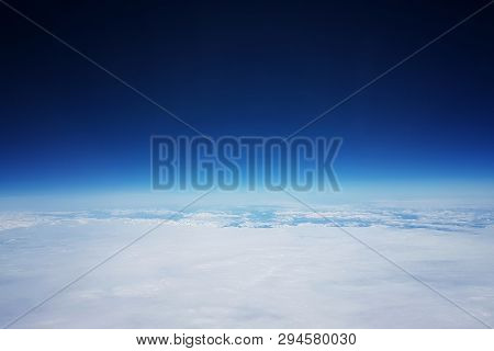Low Earth Orbit - View Of White Clouds And Mountains During The Flight To The Low Orbit Of The Earth