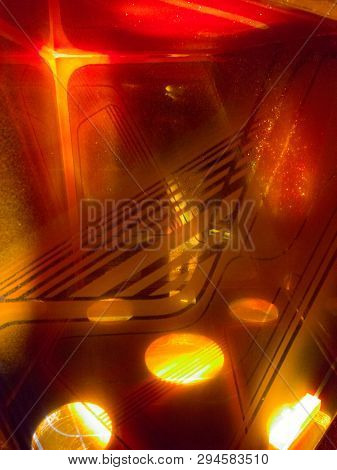 Brilliant Orange Light Shining And Reflecting Through Multiple Layers Of Glass