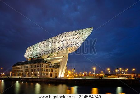 ANTWERP, BELGIUM - MAY 27, 2018: Port authority house (Porthuis) designed by famous Zaha Hadid Architects which was her last project illuminated in the night