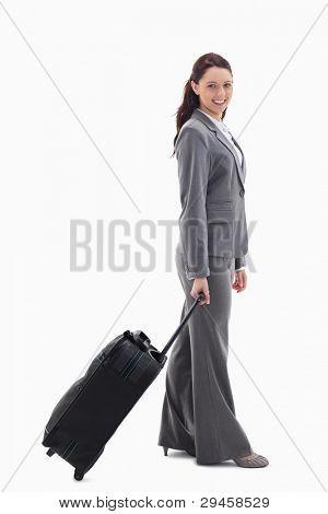 Profil anzeigen: a Businesswoman smiling mit einem Koffer against white background