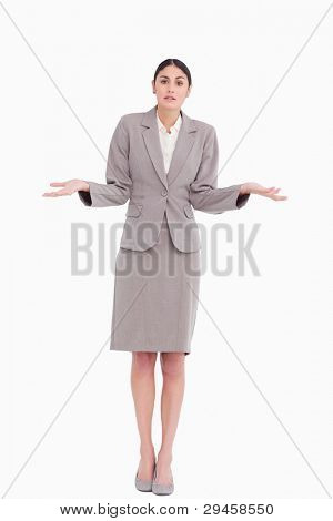Young businesswoman clueless against a white background