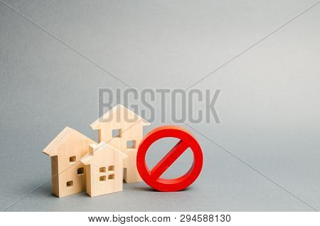 No Sign And The Wooden House On An Gray Background. Unavailability Of Housing, Busy Or Low Supply. I
