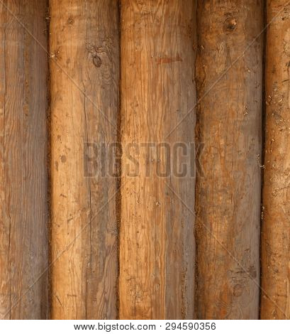 Blockhouse Background. Big Old Timber Wall. Retro Wooden Surface. Vertical Structure. Summer Day.
