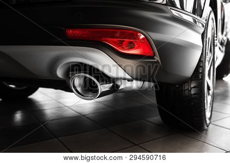 Car Exhaust Pipe. Exhaust Pipe Of A Luxury Car. Details Of Stylish Car Interior, Leather Interior. C