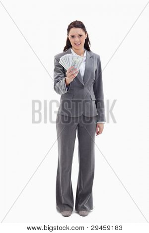 Businesswoman holding a lot of dollar bank notes against white background