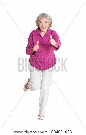 Portrait Of Senior Woman With Thumbs Up Isolated On White Background