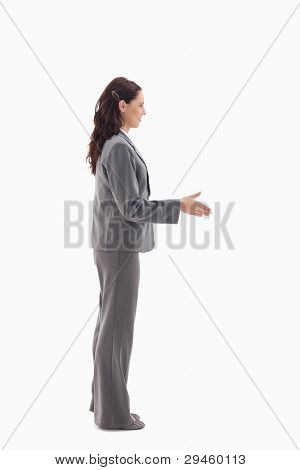 Profile of businesswoman shaking hands against white background