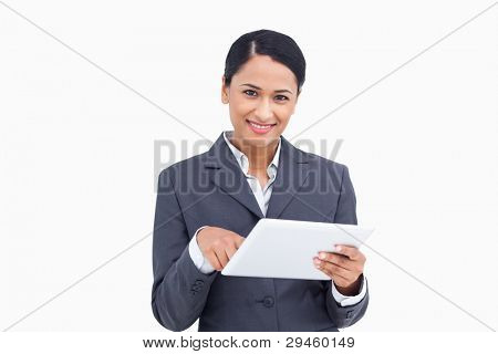 Close up of saleswoman with tablet computer against a white background