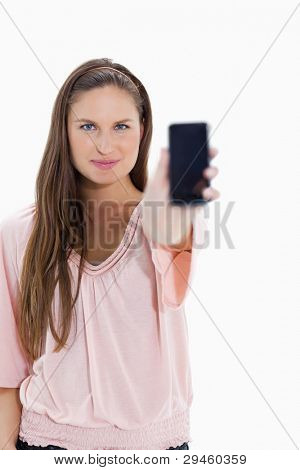 Close-up of a girl showing a smartphone against white background