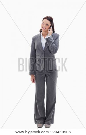Businesswoman on the phone looking up against white background