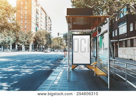 A Template Of A Blank Ad Poster Inside Of A Bus Stop; Vertical Information Banner Mock-up Placeholde