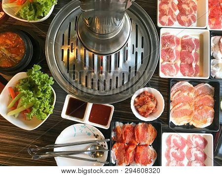 Barbecue Buffet With Gourmet Pork And Seafood Grilling Over Hot Coals