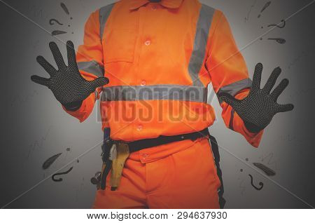 Guilty Builder Worker Justifies And Spreads His Hands Isolated On Blue Background. Construction Mist