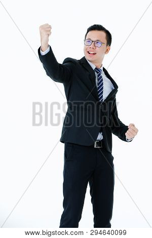 Half-length Portrait Of Young Handsome Asian Man Wearing Eyeglasses In Business Suit Posing Triumpha