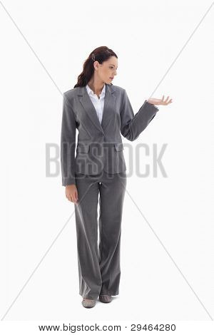 Businesswoman presenting a product against white background