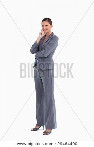 Side view of smiling tradeswoman against a white background