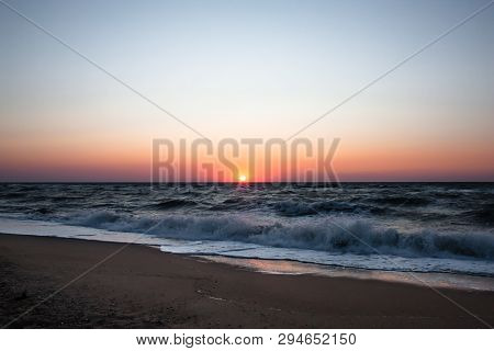 Blue Sunrise On The Sea Coast. Sunrise On A Wild Sea Beach. Sea Water Ocean Wave. Ocean View Beach.