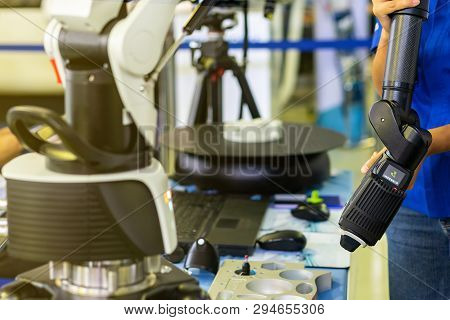 Man Or Operator Holding Head Of High Technology And Modern Automatic 3d Laser Scan For Measuring Or