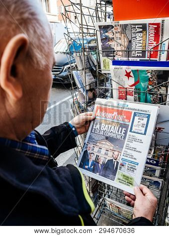 Paris, France - 29 Mar 2019: Newspaper Stand Kiosk Selling Press With Senior Male Hand Buying Latest