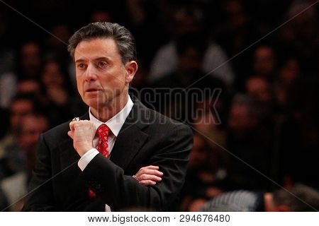 NEW YORK-MAR 10: Louisville Cardinals head coach Rick Pitino on the sidelines against the Cincinnati Bearcats during the Big East Tournament on March 10, 2012 at Madison Square Garden in New York City