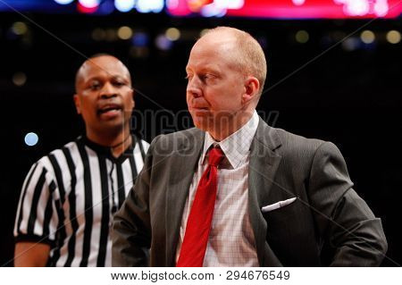 NEW YORK-MAR 10: Cincinnati Bearcats head coach Mick Cronin on sidelines  against the Louisville Cardinals during the Big East Tournament on March 10, 2012 at Madison Square Garden in New York City.