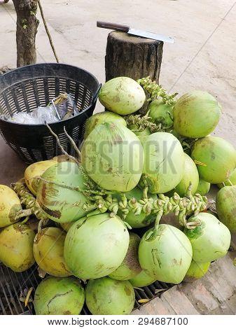 Thai Coconut street market vendor selling outdoors