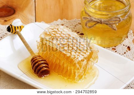 Honey Comb Piece. Honey Slice With Honey Spoon And Jar Of Honey On Wooden Table. Honeycomb Part With