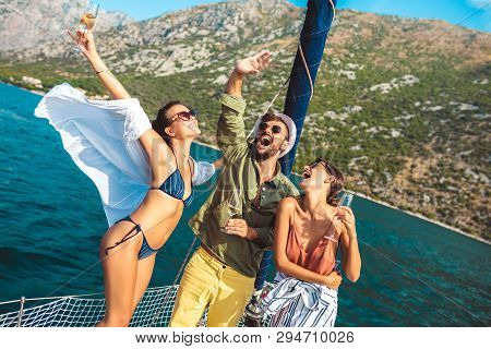 Smiling Friends Sailing On Yacht - Vacation, Travel, Sea, Friendship And People Concept