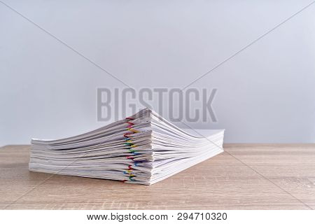 Pile Paperwork Report On Wood Table With Copy Space