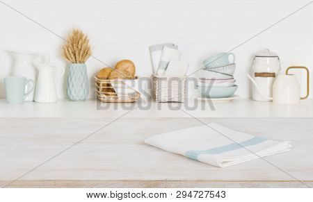 Dish Cloth On Wooden Table Over Defocused Kitchen Counter Background