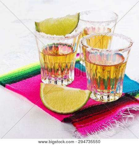 Cinco De Mayo Celebration Background. 5th May Mexican Party. Mexican Golden Tequila Shots With Lime