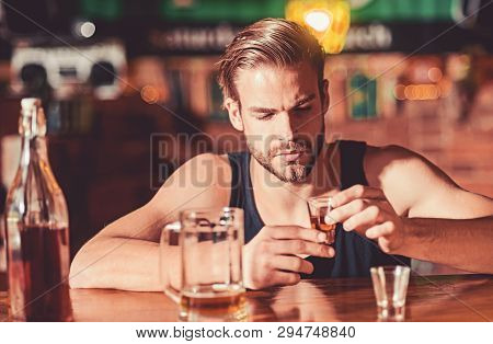 Heavy Drinking Is Bad. Alcoholic Man Drinking At Bar Counter. Man Drink Strong Alcoholic Beverage An