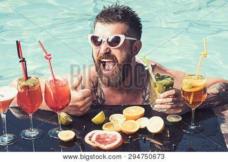 Relax At Sea And Spa Resort. Man Swimming And Drink Alcohol. Summer Vacation At Miami Or Maldives. P