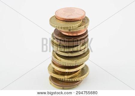 Stack Of Euro Cents Coins On White Background. Currencies Of Different Values, Five, Ten And Twenty